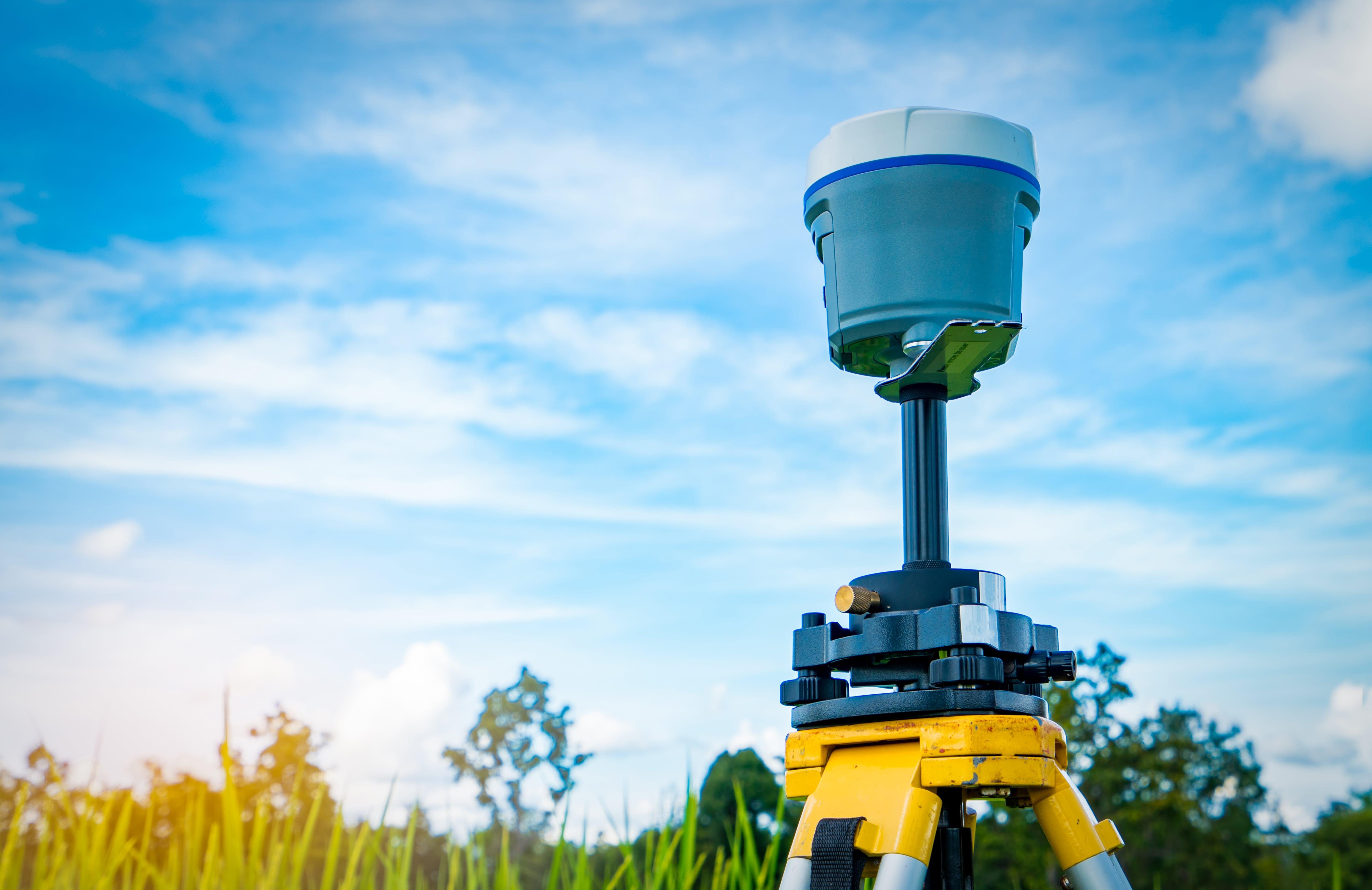 GPS surveying instrument on blue sky and rice field background © Artinun, Adobe stock